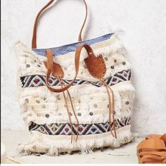 "Free People Tote Made in morocco...18""high 27.5"" wide. Zipper pouch inside. Wool and leather. striped lining. New no tags Free People Bags Totes"