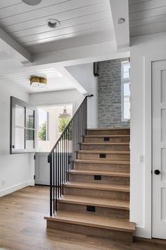 Staircase features custom metal railing and sleek White Oak threads Staircase wi… – farmhouse fireplace tile Metal Railings, Stair Railing, Modern Staircase, Staircase Design, Foyer Design, Farmhouse Interior, Modern Farmhouse, Farmhouse Fireplace, Front Courtyard