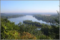 Pine Bend Bluffs SNA -- 111th St E, Inver Grove Heights (N44 47.293, W93 1.887) -- 25mi from Bloomington, just south of St. Paul off US 52 in Inver Grove Heights. Spectacular view of the Mississippi's main channel amid a maze of islands and sloughs. Great place to see eagles in the spring and hawks in the fall.