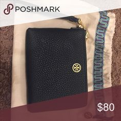 Authentic brand new Dark green Tory Burch clutch Authentic hunter green Tory Burch clutch with wrist strap and authentic new with plastic on emblem dust bag. Retail for $300 Tory Burch Bags Clutches & Wristlets