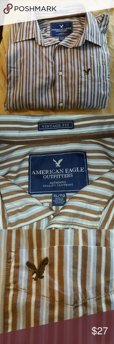?? NWOT Men's Dress Shirt NWOT American Eagle Outfitters shirt. Brown, light blue, and white stripes. AE logo on front pocket as pictured in third photo. American Eagle Outfitters Shirts Dress Shirts