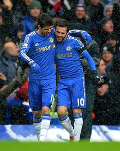 Juan Mata celebrates his goal with Oscar