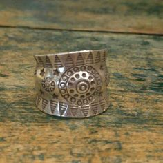 Hill Tribe Silver Bracelet Wonderful handcrafted ring made by Hill Tribe Artisians in Northern Thailand.  Ring designed to adjust to fit most ring sizes and fingers. Stamped Silver 999 New Jewelry Rings