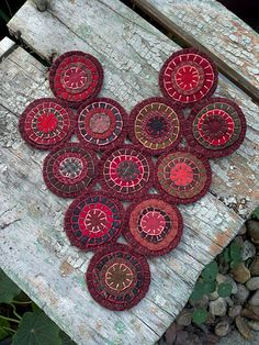 Penny rug~ love the colors on this one and the white thread~