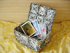 This is a cool recycled magazine box.  Not in english, but step-by-step photos make it easy to follow.