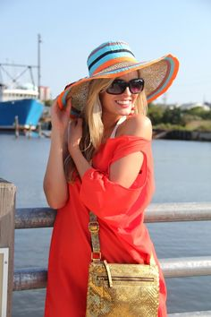 Bold colors and wide brimmed hat