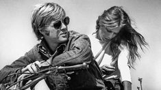 "sartorialjohnnyboy: ""Mr Robert Redford and Ms Lauren Hutton in Little Fauss and Big Halsy, 1970 Steve Schapiro/ Corbis """