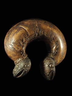 Africa | Musical Instrument. A Rattle Bracelet from Cameroon or Chad. | Clay covered with leather | This has balls within it that as you shake it around it rattles |