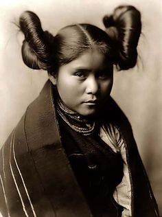 Here we present a rare image of Chaiwa, a Tewa Indian Child. It was taken in 1906 by Edward S. Curtis.    The image shows Chaiwa, a Tewa Indian girl, in a head-and-shoulders portrait, facing front. This is a beautiful child and a remarkable photograph. Notice the girl's unique hairstyle.