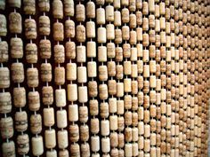 This is why I've been saving my corks. :)  Tenda di tappi - Cork curtain - Berchidda - Sardinia - Italy