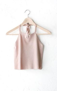 - Description - Size Guide Details: Super cute soft knit halter neck crop top in twig/light pink, square cut front & back and adjustable self-tie around the neck. Form-fitting, tend to run on the smal