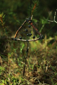 Dark wiccan dream catcher Black charm . The perfect dreamcatcher for a traveling witch. Made in a triangle form, wool thread, using ceramic beads.