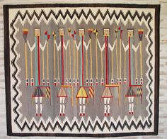 This is a yei weaving.  I love the spirit figures!