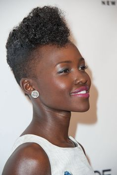 "Pin for Later: 40 Reasons Lupita Nyong'o Deserves the Title ""Most Beautiful"" Marie Claire Fresh Faces Party Lupita graces the cover of the May issue of Marie Claire, and she celebrated the accomplishment in this Elvis-esque pompadour style."