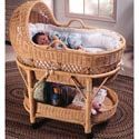 The high quality rattan frame rests on gliding casters and supports the removable bassinet basket. A hand-woven tray rests beneath the basket, providing ample space for your storage needs. Complete with a mattress, liner, and bumper, this Designer Wicker Bassinet is complete and just waiting to receive your precious bundle of joy!