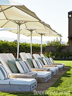 A fleet of umbrellas adds shade and style over the poolside lounge chairs. - Photo: John Merkl / Design: Hillary Thomas