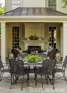 This poolside dining area is open to the stars. - Traditional Home ®/ Photo: Bob Stefko / Design: Douglas Hoerr