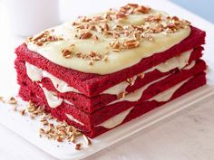 Sunny's grandma knows how to do red velvet right! She opts for a layered sheet cake for easier assembly.