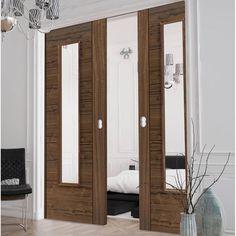 Double Pocket JBK Emral Walnut Veneered Door System in three size widths with Clear Safety Glass is Pre-finished.  #doubledoors #doorpair #internalpocketdoors