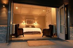 Love the wall lighting, the french doors...love it all really!