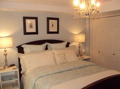 Basement Guest Bedroom, Dark basement storage room gets a make-over into a guest room.  Martha Stewart Textured Damask bedding, soft blue walls with a mix of dark walnut furniture.  , Moved the Pictures over the bed, as so many of you kindly suggested..thank you.  , Bedrooms Design