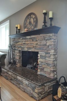 fireplaces stone/granite. Could stone the bottom half like this, then sheetrock the portion over the mantle and paint an accent color.