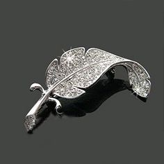 Silver Fashion Feather Brooch Pin     FREE Shipping Worldwide     http://fashjewels.de/wholsale-fashion-loved-clothes-sweater-accessories-simple-delicate-crystal-brooches-silver-colored-feather-shape-brooch-pins/