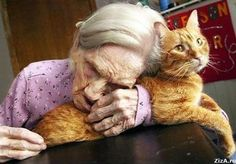 Pinner says: I Truly am in Love with this Photo- It is the most beautiful pose and truly shows such great love between the Old woman and her Cat.