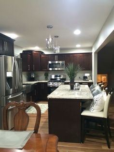 Light Granite Counters, Shaker Cocoa Cabinets And Lighter Wood Floor. Part 61