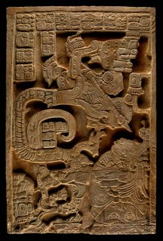 """Lady Xoc on Mayan Lintel Panel 25. She is depicted here having a supernatural experience with a so-called """"Vision Serpent,"""" an ancestor in warrior attire emerging from the mouth of an underworld snake, twisting upward from burning blood-soaked paper strips of self-sacrifice. Carved Stone. Yaxchilan Ruins, Chiapas, Mexico."""