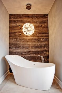 Shape of free standing tub + crystal light fixture. loveee how the tub is at an angle. Bathroom Renos, Master Bathroom, Small Bathroom, Bathrooms Decor, Zen Bathroom, Bathroom Designs, Master Bath Remodel, Plank Walls, Wood Accents