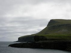 The coastline of Nolsoy is similar to that seen throughout the Faroe Islands, accompanied in this photo by the grey skies that one comes to expect in this country.