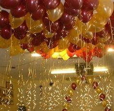 gold & burgundy balloons w/ gold ribbons as part of reunion decor