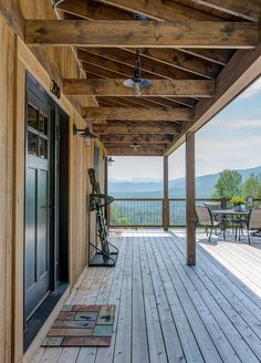 Rustic porch. Rustic porch ideas. Rustic porch flooring. Rustic porch ceiling. Rustic porch #Rustic #porch #Rusticinteirors Ski storage is from Pottery Barn. Caldwell & Johnson Custom Builders & Remodelers