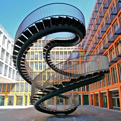 Infinity Spiral Staircase to Nowhere. It's a twist on the classic spiral staircase. It was built in 2004 by artist Olafur Eliasson, & it's on display in Munich outside an office building. It's called Umschreibung (Rewriting), & the staircase trip up is 9 meters (29.5 feet).