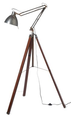 Industrial tripod floor lamp.... Could you DIY with a wood tripod telescope + a $10 Tertial task lamp from Ikea? I think yes.