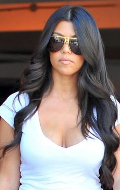 Love Kourtney Kardashian's long loose waves. (even though they are hair extensions) Chic.