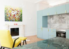 British studio Nimtim has updated a London flat with pastel blue cabinetry