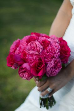 Deep pink bouquet with #carnations and #roses. Photo by Brittany Bekas Photography