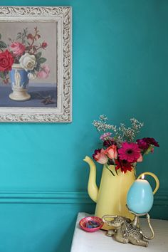 Turquoise wall and vintage roses painting