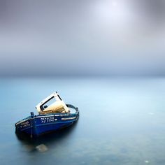 Greek photographer Vassilis Tangoulis has an incredible eye for the unique skill of almost literally pausing time.