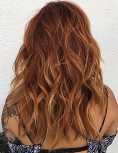 Long Wavy Auburn Hair With Subtle Highlights