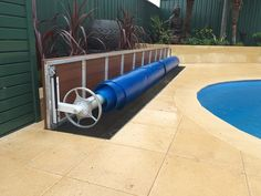They are designed to sit flush along the paving or concrete, creating a sleek, sophisticated look around your pool area. They can be installed into just about any new or existing pool area adding value to your home. Pool Cover Roller, Blanket Box, In Ground Pools, Pool Designs, Concrete, House Design, Design Ideas, Storage, Pictures