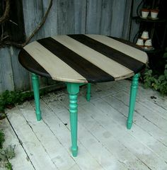 Black and white stripe and aqua painted table for an artsy style cottage house or studio; repurpose, upcycle, recycle, salvage, diy!  For ideas and goods shop at Estate ReSale & ReDesign, Bonita Springs, FL