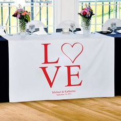 WeddingDepot.com ~ Personalized Table Runner - Love Collection - Modern Love ~ Our Love Collection Table Runners will make a fabulous addition to any reception setting! Designed to dazzle at every wedding day celebration, the fanciful table runners comes complete with free personalization and color!