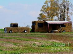 A humorous sculpture created out of hay bales in the countryside depicting a truck with trailer. Click image to buy prints or cards.