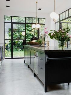 Luxury Kitchen Modern black kitchen island with concrete floor and steel windows on Thou Swell - It's not a contradiction to call this modern London townhouse British and leafy. It's easier to associate London style with dark wood paneling and wingback Black Kitchen Island, Farmhouse Kitchen Island, Modern Farmhouse Kitchens, Black Kitchens, Luxury Kitchens, Home Kitchens, Vintage Farmhouse, Contemporary Kitchens, Farmhouse Sinks