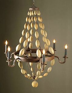 Make a statement in your home with a #DIY Wood Bead Chandelier! #crafty