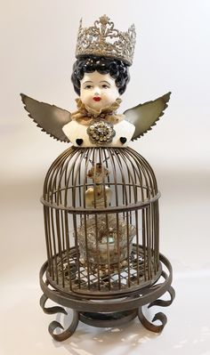 """""""No Fear"""" Assemblage piece - brass bird cage, 1955 porcelain doll head, stainless wings, gilded heart filled with dirt from Chimayo, real birds nest w/ ceramic blue egg  #Artdoll #assemblagedoll Blue Eggs, Assemblage Art, Doll Head, Bird Cage, Cute Drawings, Altered Art, Art Dolls, Birds, Assemblages"""