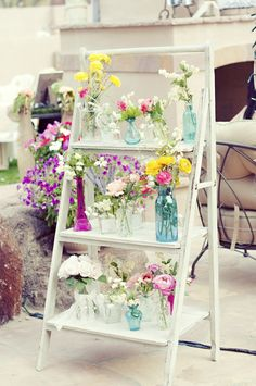 I like the idea of this (or maybe an old-fashioned ladder?) with flowers and candles and photos of family